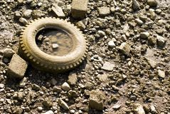 Muddy River Tire. A discarded tire on the muddy banks of a receded river stock photos