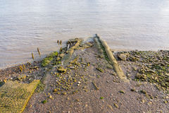 Muddy riverbank at low tide on the River Thames stock images