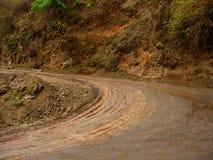 Muddy road bend Stock Photos