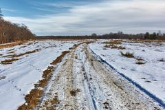 Muddy road with snow Royalty Free Stock Photos