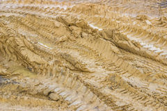 Muddy road with tire tracks and puddles Stock Photography