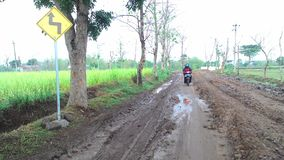 A muddy road in the village limits Stock Photography