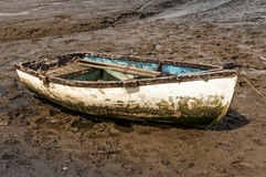 muddy rowing boat Stock Photo