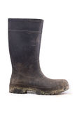Muddy rubber boot side view isolated on white. Background Royalty Free Stock Photos