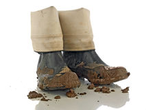 Muddy rubber boots Royalty Free Stock Photography