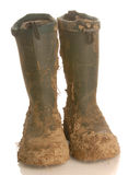 Muddy rubber boots Royalty Free Stock Image