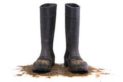 Muddy rubber boots front view Royalty Free Stock Photo