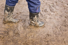 Muddy rubber boots Royalty Free Stock Photos