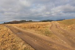Muddy rural road, autumn landscape, crossroads,rural dirt road. Royalty Free Stock Image