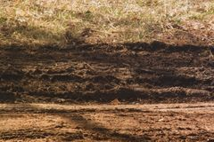 Muddy ruts left in dry field royalty free stock photography