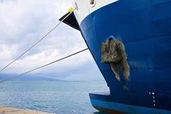 Muddy Ship's Anchor Stock Photo