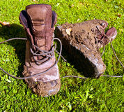 Muddy walking boots  Stock Images