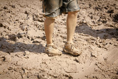 Muddy Shoes and Legs Royalty Free Stock Image
