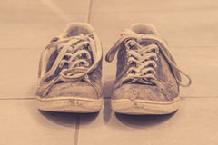 Muddy shoes in sepia color Stock Image