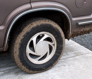 Muddy SUV Tire on Car. RnrnA muddy SUV tire on the car after a day of fun.rnrnrn royalty free stock photography