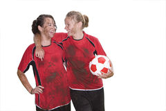 Muddy teenage girls laughing and holding soccer ball, cut out Royalty Free Stock Photo