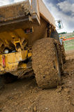 Muddy Truck. Tipper truck with muddy rear wheel royalty free stock image