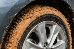 Muddy tyre. Dirty mud on tyre of vehicle Stock Photos