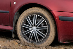 Muddy tyre Stock Images