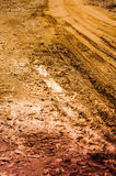 Muddy Village Road With Truck Tracks Royalty Free Stock Photos
