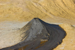 Muddy Volcano. Picure of a muddy volcano and its mud lava in Paclele Mici, Buzau, Romania Royalty Free Stock Photography