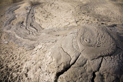 Muddy volcanos in Romania spilling mud Stock Photos