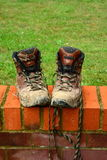 Muddy walking boots Stock Photography