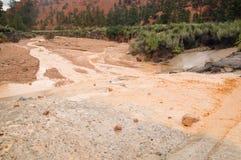 Muddy water from flash flood in Utah desert Royalty Free Stock Photos