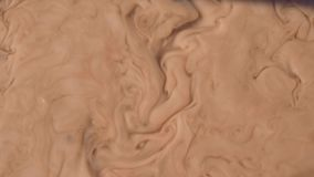 Muddy water flow, brown soil with natural organic clay and geological sediment mixture as in rughing brook. After the rain or rainy season found in a damp moist stock video footage
