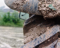 Muddy wet tractor tire Stock Photo