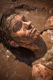 Muddy woman Stock Photography