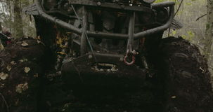 The muddy 4x4 offroad vehicle stuck in the muddy forest FS700 4K stock video footage