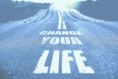Mude sua vida escrita na estrada toned Imagens de Stock