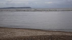 Mudeford beach near Christchurch Dorset UK with view to the Needles Isle of Wight stock video footage