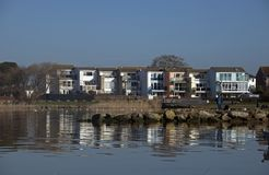 Mudeford Quay Christchurch Dorset. Colurful Houses Reflecting in the Harbour at Mudeford Quay Stock Photo