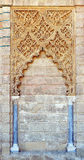 Mudejar facade of the Palace of Peter 1, Alcazar Royal in Seville, Spain. Details of the Moorish plasterwork, Mudejar facade of the Palace of Peter 1, Courtyard Royalty Free Stock Image
