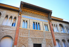 Mudejar facade of the Palace of Peter 1, Alcazar Royal in Seville, Spain. Details of the Moorish plasterwork, Mudejar facade of the Palace of Peter 1, Courtyard Royalty Free Stock Photo