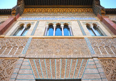 Mudejar facade of the Palace of Peter 1, Alcazar Royal in Seville, Spain. Details of the Moorish plasterwork, Mudejar facade of the Palace of Peter 1, Courtyard Stock Photos