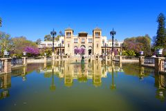 The mudejar pavilion and pond placed in the Plaza de America, ho. Uses the Museum of Arts and Traditions of Sevilla, Andalusia, Spain Royalty Free Stock Photo