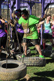 2014 Muderrella Mud Race Tire Swing Obstacle Royalty Free Stock Photography