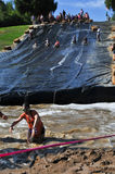 2014 Muderrella Mud Race Water Slide Obstacle Royalty Free Stock Image