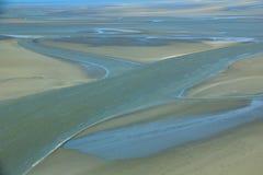 Mudflat at low tide Stock Photos