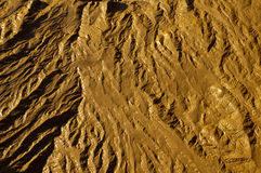 Mudflats. Close-up abstract of wet mud on a tidal river shore. Suitable as an abstract, patterned background Stock Images