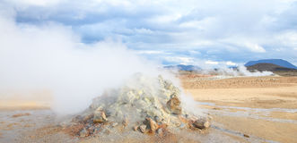 Fumarole evacuating pressurized hot sulfurous gases from volcanic activity in the geothermal area of Hverir Iceland, Lake Myvatn. Royalty Free Stock Image