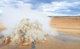 Fumarole evacuating pressurized hot sulfurous gases from volcanic activity in the geothermal area of Hverir Iceland near Lake Myva Stock Photos