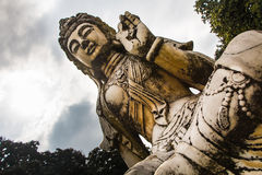 Mudra meditation. Statue oblique representing a lotus position and mudra with cloudy sky royalty free stock images