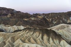 Mudstone badlands at Zabriskie Point at dawn, Death alley National Park, California. Mudstone and claystone badlands at Zabriskie Point at dawn, Death Valley Stock Images