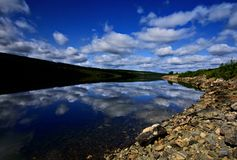 Mudus national park. Lonely lake with beautiful sky Stock Photos