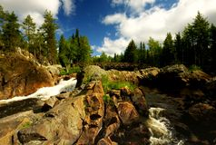 Mudus national park. River flowing through red stones in mudus national park in sweden Royalty Free Stock Image