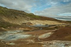 Mudy thermal springs in Iceland. Interesting hilly landscape. Multicolored breeds. Royalty Free Stock Photo